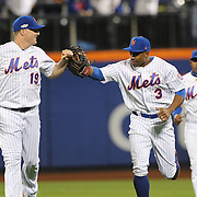 NEW YORK, NEW YORK - October 5:  Curtis Granderson #3 of the New York Mets is congratulated by Jay Bruce #19 of the New York Mets after making a spectacular catch at center field off Brandon Belt #9 of the San Francisco Giants in the sixth inning during the San Francisco Giants Vs New York Mets National League Wild Card game at Citi Field on October 5, 2016 in New York City. (Photo by Tim Clayton/Corbis via Getty Images)
