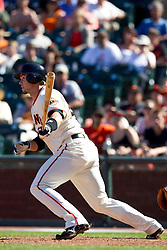 May 30, 2010; San Francisco, CA, USA;  San Francisco Giants second baseman Freddy Sanchez (21) hits a single against the Arizona Diamondbacks during the tenth inning inning at AT&T Park.  San Francisco defeated Arizona 6-5 in 10 innings.
