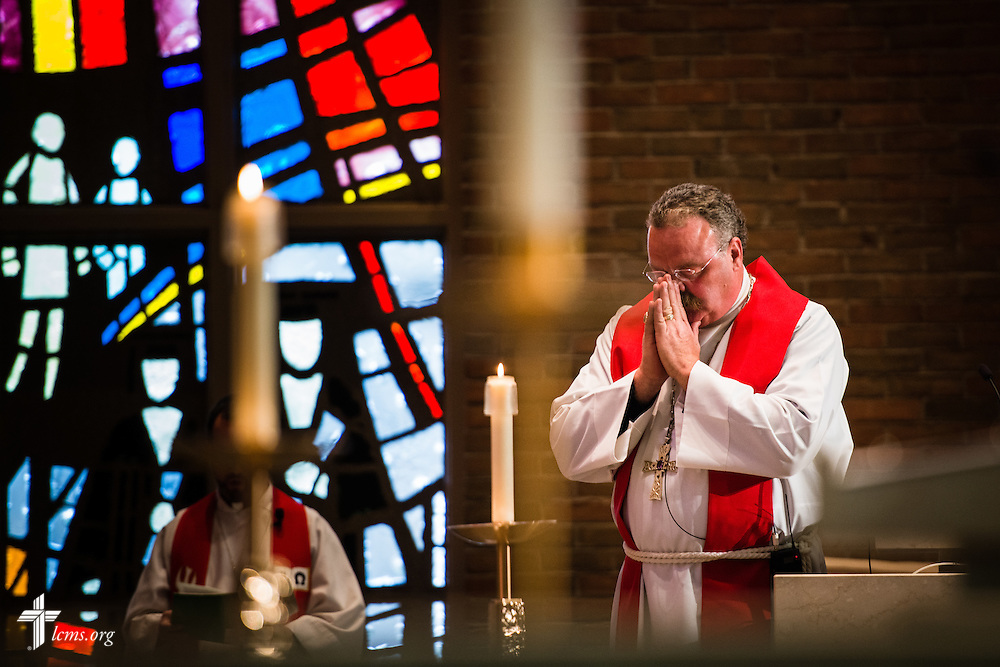 The Rev. Dr. Matthew C. Harrison, president of The Lutheran Church–Missouri Synod, prays before he preaches at the Service of Praise Commemorating the Sesquicentennial of Concordia University Chicago, in the Chapel of Our Lord on the university campus in River Forest, Ill., on Sunday, Oct. 12, 2014. LCMS Communications/Erik M. Lunsford