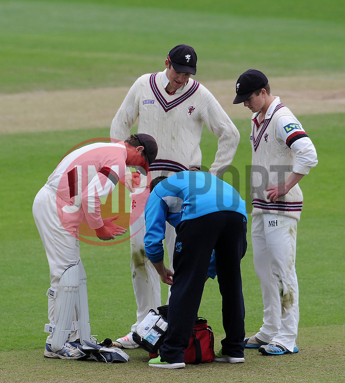 Somerset's Alex Barrow receives attention to an injured finger. Photo mandatory by-line: Harry Trump/JMP - Mobile: 07966 386802 - 10/05/15 - SPORT - CRICKET - Somerset v New Zealand - Day 3- The County Ground, Taunton, England.