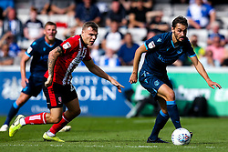 Edward Upson of Bristol Rovers takes on Harry Anderson of Lincoln City - Mandatory by-line: Robbie Stephenson/JMP - 14/09/2019 - FOOTBALL - Sincil Bank Stadium - Lincoln, England - Lincoln City v Bristol Rovers - Sky Bet League One