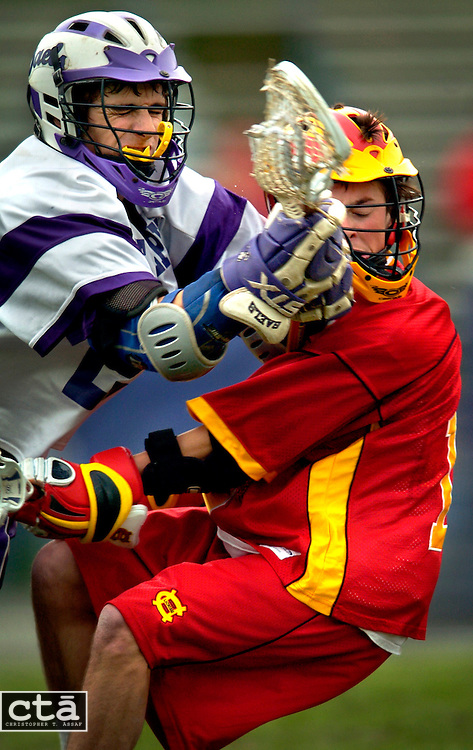 Mount St. Joseph midfielder Sam Buppert (24) knocks Calvert Hall midfielder Phil Blevins (16) as he tries to get to the ball during their hard-fought game at Mount St. Joseph. Buppert was called for a foul on the play, and visiting Calvert Hall won 6-5 in overtime.