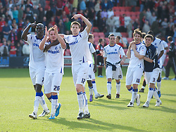 BOURNEMOUTH, ENGLAND - Saturday, April 9, 2011: Tranmere Rovers' Enoch Showunmi (L) and Ash Taylor (R) point to Adam McGurk (C) whose winning goal gave Tranmere a 2-1 win over Bournemouth during the Football League One match at the Dean Court Stadium. (Photo by Gareth Davies/Propaganda)