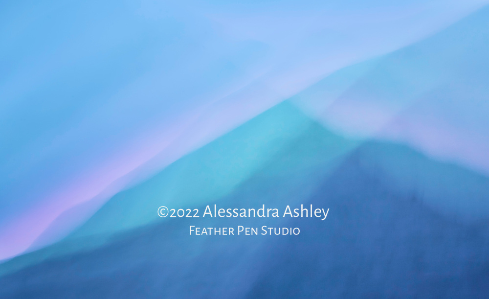 Ridges of Tennessee's Smoky Mountains at sunset.  Painterly effect added with camera movement  during long exposure.  Great Smoky Mountains National Park near Gatlinburg, TN.