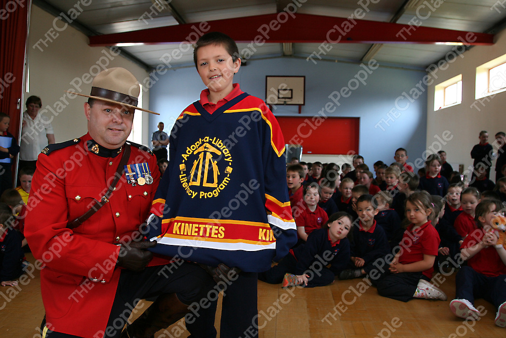 Paraick McMahon of Scoil Maighdine Mhuire in Newmarket-on-Fergus was delighted when John Kennedy of the Royal Canadian Mounted Police presented him with a ice hockey jersey during his visit to the school on Friday.<br />