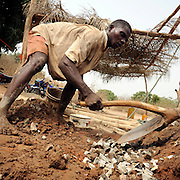 Beninese man builds a well at the village of Kpataba, Benin February 24, 2008.