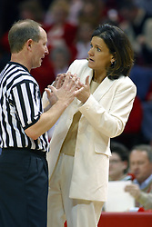 12 March 2005<br /> <br /> Coach Robin Pingeton leans into her discusion with an official trying to make her point.<br /> <br /> 8th seed and Tournament Host, Illinois State University Redbirds, played spoiler and best the #1, #2 & #4 ranked teams to win the Missouri Valley Confernce Hoops in the Heartland Tournament.  In the final game today, the Redbirds bested the #2 seeded Indiana State University Sycamores by 2 points with a .8 second to go buzzer beater jump shot from the middle of the lane.  The Redbirds get an automatic birth to the NCAA Tournament. The Redbirds last played in the NCAA Tournament in 1989.  Hoops in the Heartland was held at Redbird Arena, Illinois State University, Normal IL