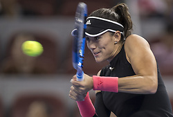 BEIJING , Oct. 2, 2018  Garbine Muguruza of Spain hits a return during the women's singles second round match against Aryna Sabalenka of Belarus at China Open tennis tournament in Beijing, China, Oct. 2, 2018. Garbine Muguruza lost 0-2. (Credit Image: © Fei Maohua/Xinhua via ZUMA Wire)