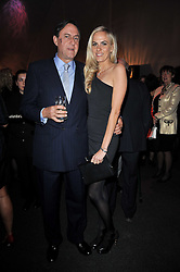 The MARQUESS OF NORTHAMPTON and his daughter LADY LOUISA COMPTON at the KIDS 40th Birthday Gala Dinner held in the Boiler House at Battersea Power Station, London on 10th March 2011.