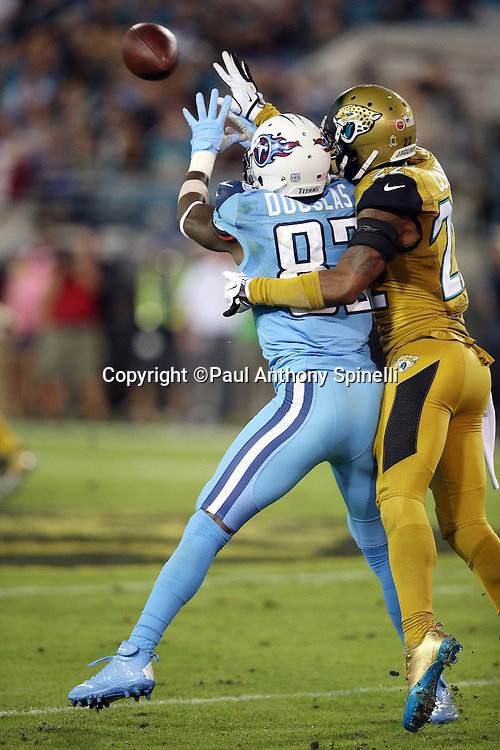 Tennessee Titans wide receiver Harry Douglas (83) reaches for the ball while trying to catch a second quarter pass defended by Jacksonville Jaguars cornerback Aaron Colvin (22), holding called on the play, during the 2015 week 11 regular season NFL football game against the Jacksonville Jaguars on Thursday, Nov. 19, 2015 in Jacksonville, Fla. The Jaguars won the game 19-13. (©Paul Anthony Spinelli)