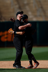 OAKLAND, CA - AUGUST 25: Will Smith #13 of the San Francisco Giants celebrates with Evan Longoria #10 after the game against the Oakland Athletics at the RingCentral Coliseum on August 25, 2019 in Oakland, California. The San Francisco Giants defeated the Oakland Athletics 5-4. Teams are wearing special color schemed uniforms with players choosing nicknames to display for Players' Weekend. (Photo by Jason O. Watson/Getty Images) *** Local Caption *** Will Smith; Evan Longoria