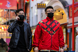 © Licensed to London News Pictures. 29/01/2020. London, UK. Men are seen in London's Chinatown wearing fashionable face masks following the outbreak of Coronavirus in Coronavirus in Wuhan, China which has killed 132 people and infected more than 6,000. According to the Department of Heath, 97 people have been tested for Coronavirus in the UK and all have been confirmed negative. Photo credit: Dinendra Haria/LNP