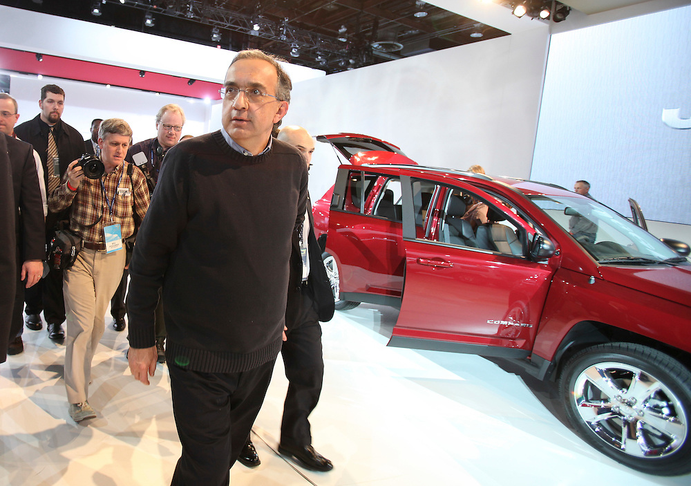 GR --- Detroit, Michigan ---11-01-10--- Chrysler CEO Sergio Marchionne tours the Jeep display following the company's press conference at the North American International Auto Show in Detroit, Michigan January 10, 2011.<br /> Geoff Robins AFP
