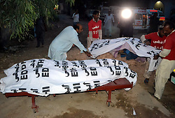 May 5, 2017 - Hyderabad, Sindh, Pakistan - EDHI employees are carrying the dead body due to the heat stoke in Hyderabad city the total death are 3 on May 5 (Credit Image: © Janali Laghari/Pacific Press via ZUMA Wire)