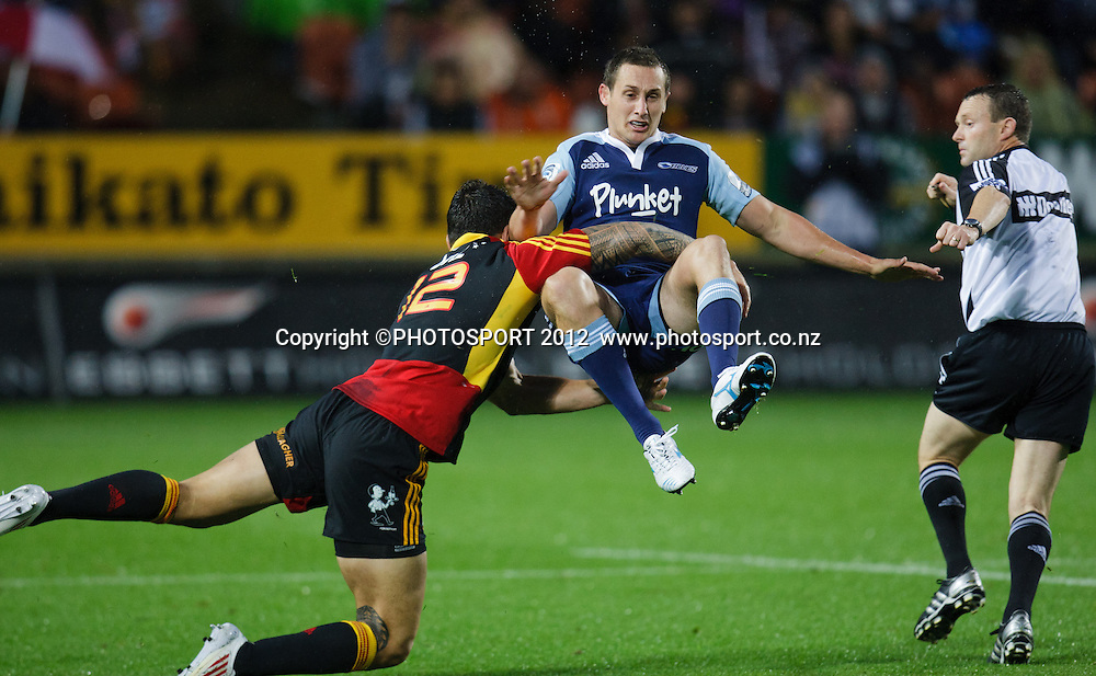 Blues' Michael Hobbs tackled by Sonny Bill Williams during the 2012 Super Rugby season, Chiefs v Blues match at Waikato Stadium, Hamilton, New Zealand, Friday 2 March 2012. Photo: Stephen Barker/PHOTOSPORT