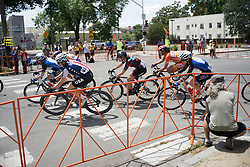 A small group of riders exit a corner during the fourth, 70 km road race stage of the Amgen Tour of California - a stage race in California, United States on May 22, 2016 in Sacramento, CA.
