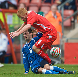 WREXHAM, WALES - Saturday, October 10, 2009: Wales' Marc Williams and Bosnia-Herzegovina's Muhamed Subasic during the UEFA Under-21 Championship Qualifying Round Group 3 match at the Racecourse Ground. (Pic by Chris Brunskill/Propaganda)
