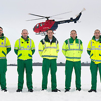 SCAA..Scotland's Charity Air Ambulance have started to train the five paramedics who will man the new Air Ambulance to be based in Perth, pictured from left are paramedics Alex Holden from Falkirk, Bruce Rumgay from Dundee, Wayne Auton from Tarbet, Andy Walker from Milnathort and John Pritchard from Crieff. Also pictured is a Bolkow 105 from Bond Aviation Services who have been chosen to provice the aircraft for SCAA and it joined up with the paramedics in a snowy Perth to start the training process....24.01.13<br /> For further info contact Maureen Young on 07778 779888<br /> Picture by Graeme Hart.<br /> Copyright Perthshire Picture Agency<br /> Tel: 01738 623350  Mobile: 07990 594431
