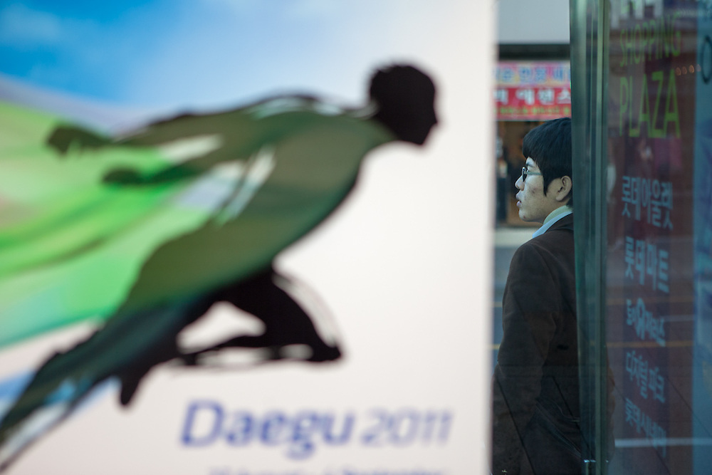 Daegu/South Korea, Republic Korea, KOR, 03.11.2010: Advertising for the 2011 World Championships in Athletics which will take place in the South Korean city of Daegu at a local bus stop.