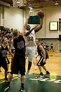 1/6/2006: Junior forward Joe Davis (32) of the UAA Seawolves goes for a jump hook over Bryan Freshwater of the Central Washington Wildcats as Anchorage goes on to beat the visiting Central Washington Wildcats, 80-60 at the Wells Fargo Sports Complex on the campus of UAA.<br />