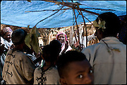 "Parents, relatives and friends of two young girls, who are being married, dance during a celebration of the early marriage. North West of Ethiopia, on friday, Febrary 13 2009.....In a tangled mingling of tradition and culture, in the normal place of living, in a laid-back attitude. The background of Ethiopia's ""child brides"", a country which has the distinction of having highest percentage in the practice of early marriages despite having a law that establishes 18 years as minimum age to get married. Celebrations that last days, their minds clouded by girls cups of tella and the unknown for the future. White bridal veil frame their faces expressive of small defenseless creatures, who at the age ranging from three to twelve years shall be given to young brides men adults already...To protect the identities of the recorded subjects names and specific places are fictional."