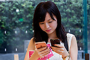 Momoko Toyotake using iPhone 7 (right and iPhone 7 plus at the launch of the new iPhone at the Apple store in Omotesando, Tokyo, Japan. Friday September 16th 2016. The iPhone launches are global events. Around 200 eager customers waited outside the Apple store in Tokyo, some for several days, to be first in line to buy the new product.