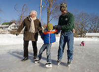 Rudy Young (center) getting the feel of his skates with help from his Great Aunt Pamela Prescott and Wayne Pierce from Laconia Parks and Recreation during Skate Time at Memorial Park Friday afternoon.  (Karen Bobotas/for the Laconia Daily Sun)