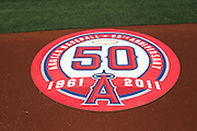 ANAHEIM - APRIL 10:  The Los Angeles Angels of Anaheim 50 year anniversary logo adorns the on-deck batting circle during the game between the Toronto Blue Jays and the Los Angeles Angels of Anaheim at Angel Stadium in Anaheim, California on Sunday April 10, 2011. The Angels won the game 3-1. (Photo by Paul Spinelli/MLB Photos via Getty Images)