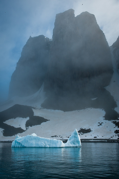 An iceberg floats in front of Salisbury Island, Franz Josef Land.