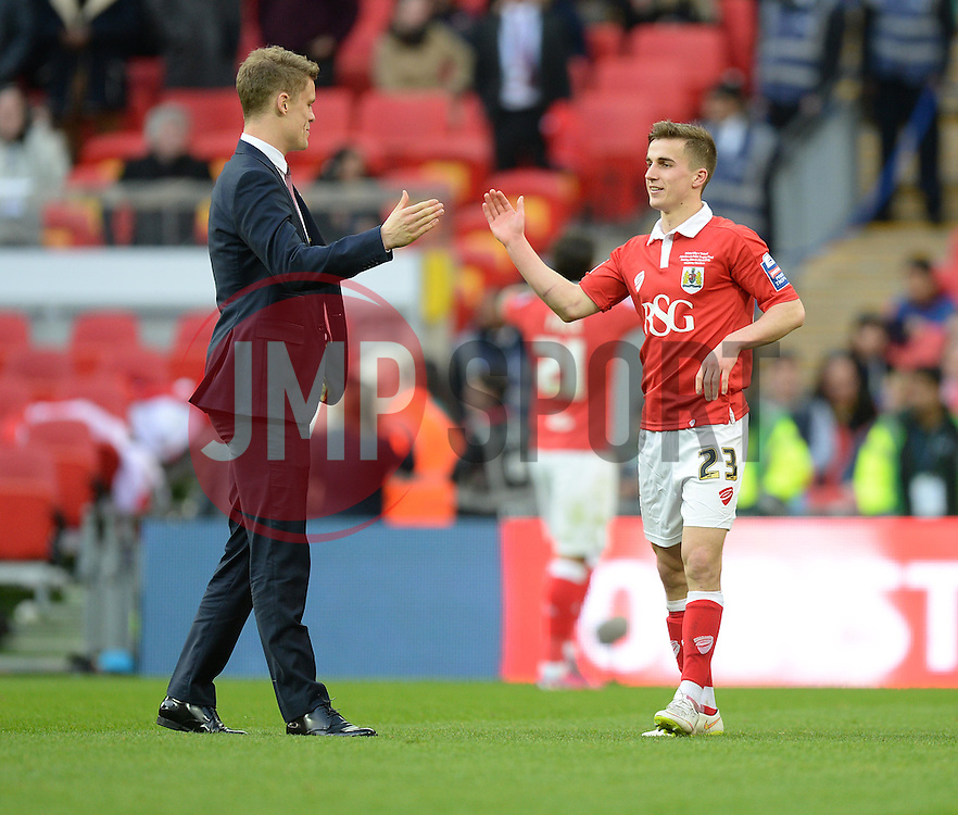 Former Bristol City Player Matt Smith celebrates with Bristol City's Joe Bryan at full time. - Photo mandatory by-line: Alex James/JMP - Mobile: 07966 386802 - 22/03/2015 - SPORT - Football - London - Wembley Stadium - Bristol City v Walsall - Johnstone Paint Trophy Final