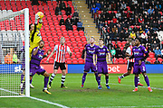 James McKeown (1) of Grimsby Town makes a save during the EFL Sky Bet League 2 match between Exeter City and Grimsby Town FC at St James' Park, Exeter, England on 29 December 2018.