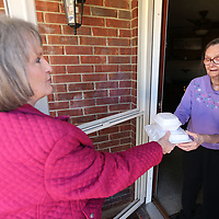 Colita Corder, a Meals on Wheels volunteer, delivers a meal to Sara LaPrade at her Tupelo residence on Wednesday. Corder has been volunteering for Meals on Wheels for 15 years.