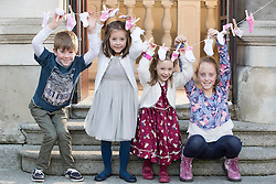 Repro Free: 14/11/2014 <br /> Little heroes &ldquo;sock it&rdquo; to &lsquo;em for World Prematurity Day<br /> Little heros Harry (8) and Holly Daly (6) from Rathoath, Saoirse Madden (5) from Ballincollig Co. Cork and Amelia McDermott (8) from Bray Co. Wicklow are pictured with TD Jerry Buttimer, who was also born premature, showing how much they&rsquo;ve grown out of the socks they wore as premature babies. They were celebrating the upcoming World Prematurity Day on Monday 17th November at an event hosted by the Irish Neonatal Health Alliance and supported by AbbVie.  Picture Andres Poveda