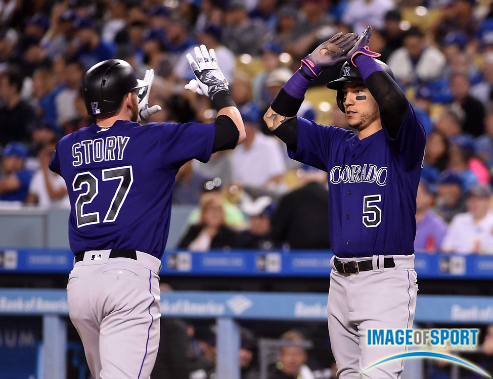Jun 6, 2016; Los Angeles, CA, USA; Colorado Rockies shortstop Trevor Story (27) celebrates with Colorado Rockies right fielder Carlos Gonzalez (5) after hitting a three-run home run in the fifth inning against the Los Angeles Dodgers during a MLB game at Dodger Stadium.