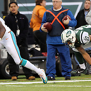 Mike Wallace, Miami Dolphins, avoided the tackle of Dee Milliner, New York Jets to score a touchdown during the New York Jets Vs Miami Dolphins  NFL American Football game at MetLife Stadium, East Rutherford, NJ, USA. 1st December 2013. Photo Tim Clayton