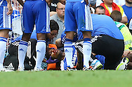 Players from both sides look concerned as Didier Drogba lies unconscious during the Barclays Premier League match at Stamford Bridge stadium, London...Picture by Paul Chesterton/Focus Images Ltd.  07904 640267.27/8/11