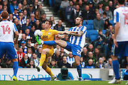 Jordan Hugill of Preston shields the ball from Brighton defender Shane Duffy during the EFL Sky Bet Championship match between Brighton and Hove Albion and Preston North End at the American Express Community Stadium, Brighton and Hove, England on 15 October 2016. Photo by Bennett Dean.