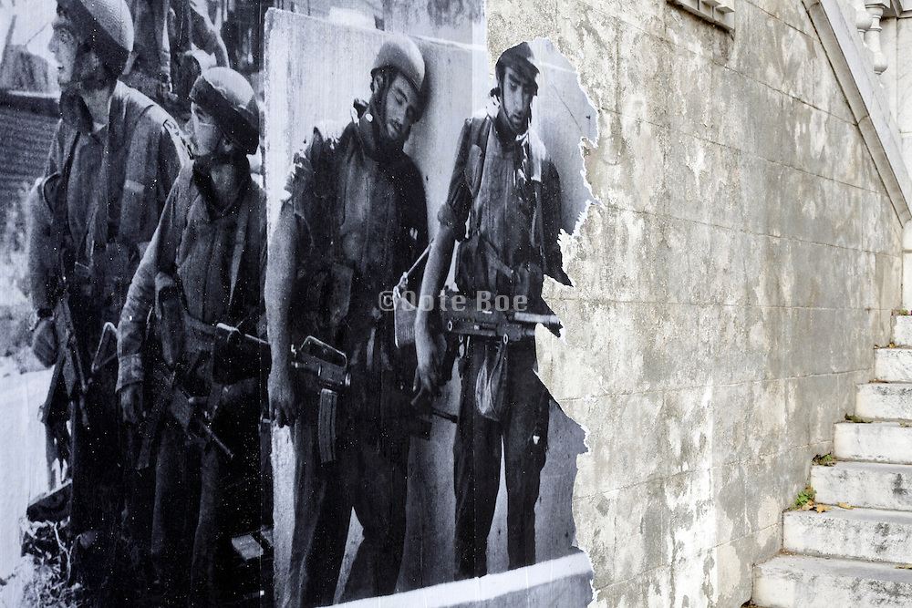 torn wall poster of Israeli soldiers during the September 1982 attack on West Beirut. Perpignan, Visa Pour l'Image 2014 poster photo by Bendit Gysembergh for Paris Match