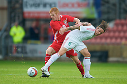 Wrexham, Wales - Wednesday, August 12th, 2009: Wales' Marc Williams and Hungary's Adam Vass during the UEFA Under 21 Championship Qualifying Group 3 match at the Racecourse Ground. (Photo by Chris Brunskill/Propaganda)