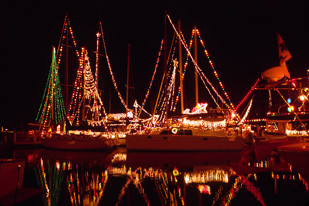boats in marina with Christmas decorations and lights; festive; holiday
