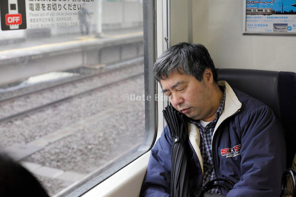 passenger during a commuting nap Japan