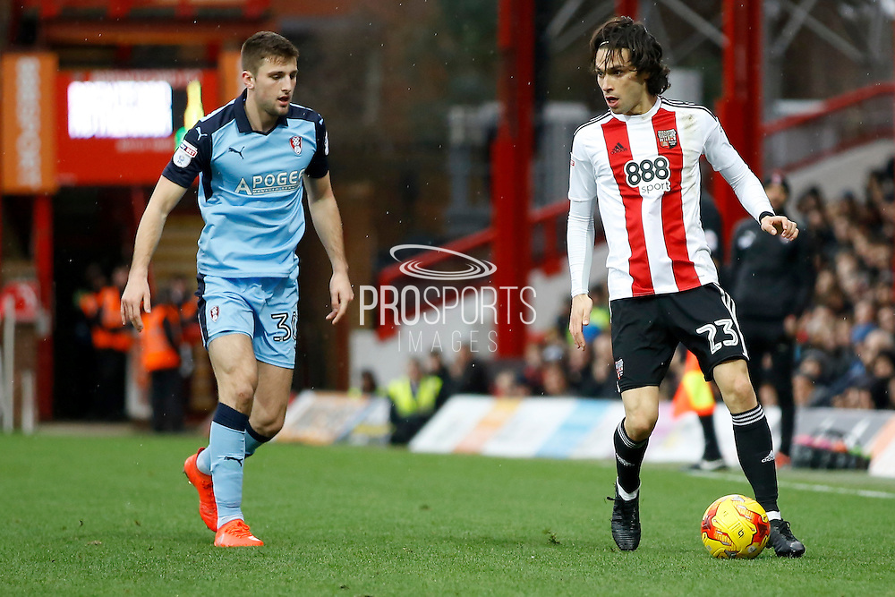 Brentford midfielder Jota (23) holds the ball up against Rotherham United midfielder Richard Smallwood (33) during the EFL Sky Bet Championship match between Brentford and Rotherham United at Griffin Park, London, England on 25 February 2017. Photo by Andy Walter.
