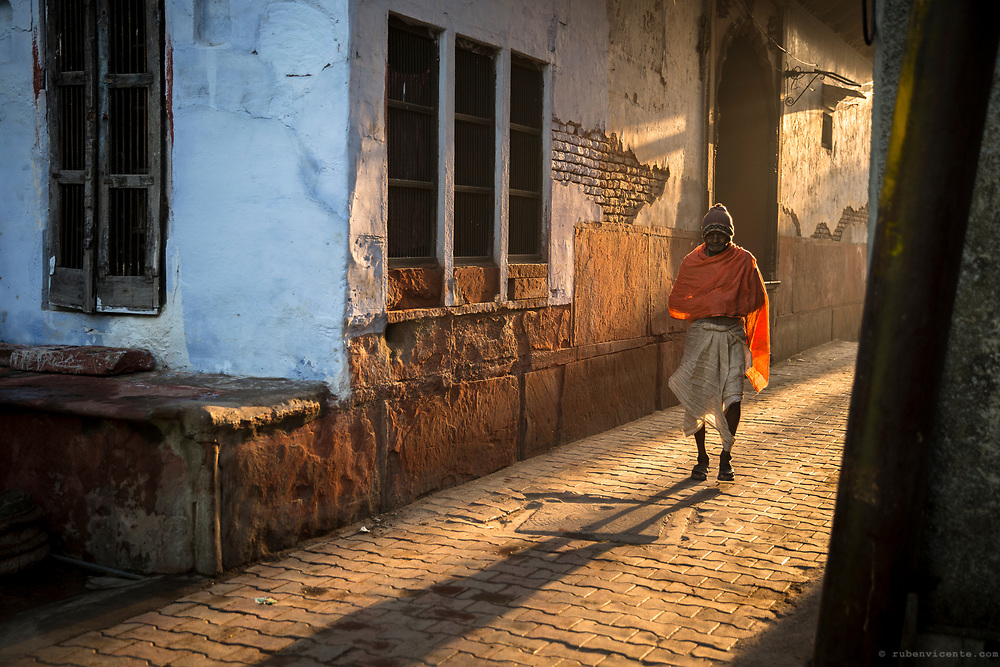 Man walking down a Vrindavan alley. India