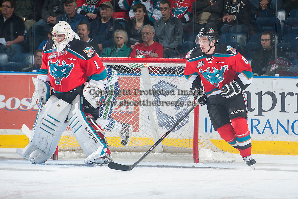 KELOWNA, CANADA - OCTOBER 7: Colten Martin #8 skates around the net of Jackson Whistle #1 of Kelowna Rockets on October 7, 2014 at Prospera Place in Kelowna, British Columbia, Canada.  (Photo by Marissa Baecker/Getty Images)  *** Local Caption *** Colten Martin; Jackson Whistle;'
