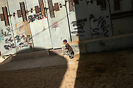 A young boy plays in a protected playground in Hebron's Jewish community. Some 600 Jews live in the heart of the old city surrounded by over 160,000 Palestinian inhabitants.<br /> Hebron, Israel. 01/11/2007