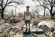 Edward Young stands on the stairs of what hurricane Katrina left of his house in the seaside town of Long Beach, Mississippi. High surge of water and strong winds flattened homes for hundred meters inland. 05 September 2005.