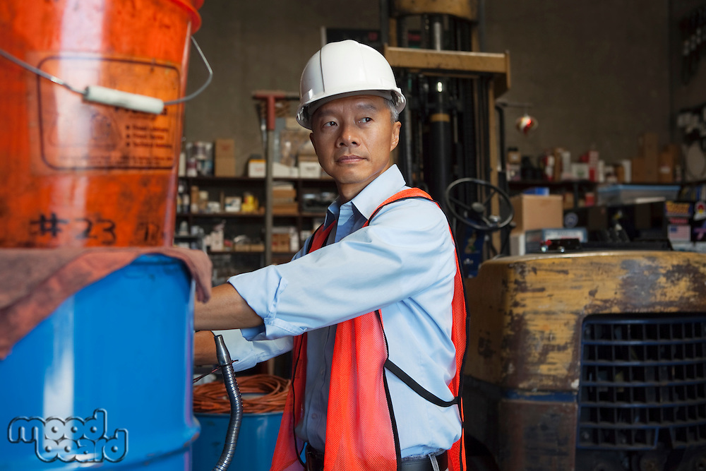Middle-aged manager looking at something in warehouse
