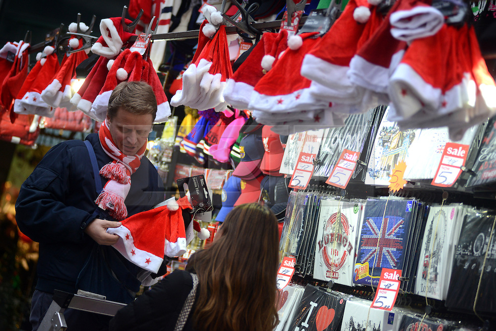 © Licensed to London News Pictures.05/12/2013. London, UK. A vendor sells Christmas presents on Oxford Street.Photo credit : Peter Kollanyi/LNP