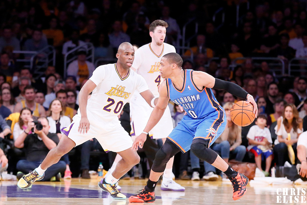 09 March 2014:  Los Angeles Lakers shooting guard Jodie Meeks (20) defends on Oklahoma City Thunder point guard Russell Westbrook (0) during the Los Angeles Lakers 114-110 victory over the Oklahoma City Thunder at the Staples Center, Los Angeles, California, USA.