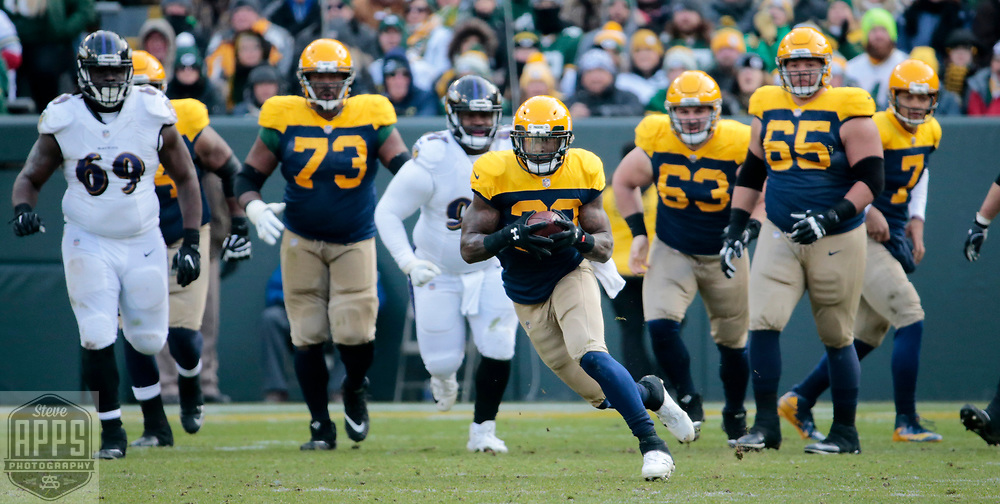 Green Bay Packers running back Jamaal Williams (30) on a 14-yard catch and run in the 3rd quarter. <br /> The Green Bay Packers hosted the Baltimore Ravens at Lambeau Field Sunday, Nov. 19, 2017. The Packers lost 23-0. STEVE APPS FOR THE STATE JOURNAL.